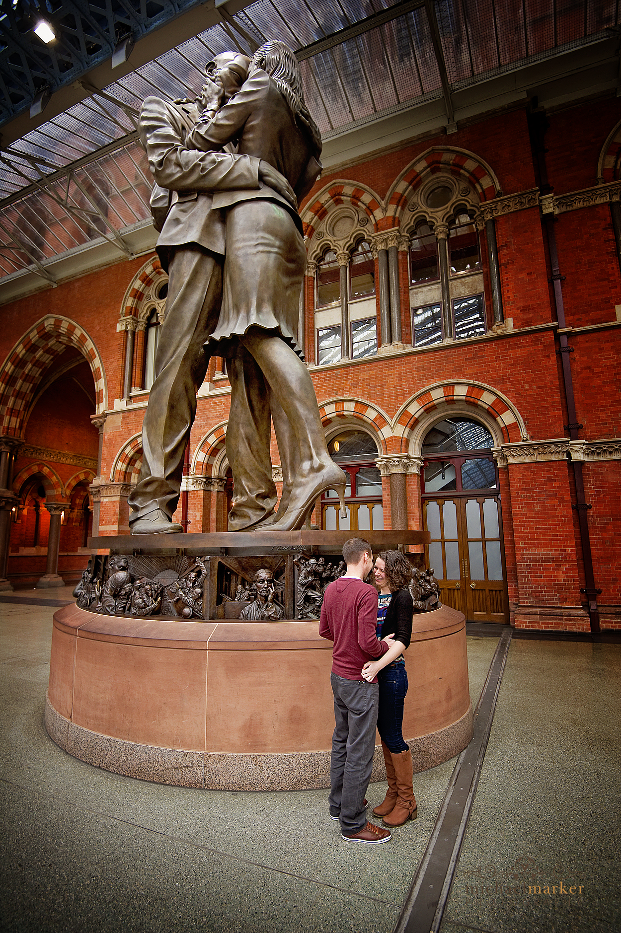 Kissing couple at St Pancras in London