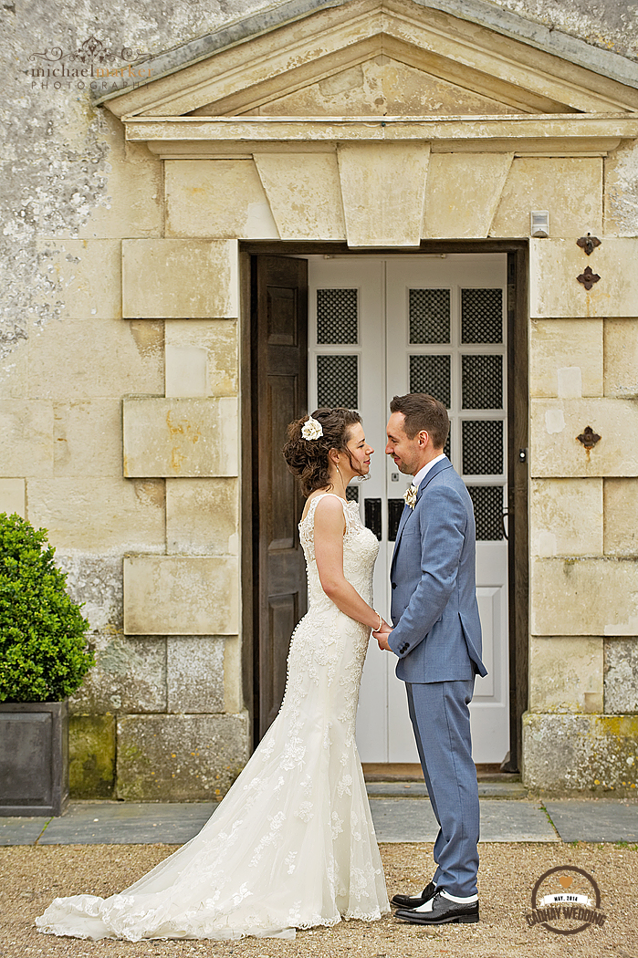 Couple on weddng day in front of Cadhay Manor in Devon