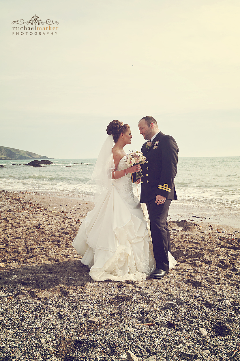 Bride and groom looking into each others eyes on Wembury Beach