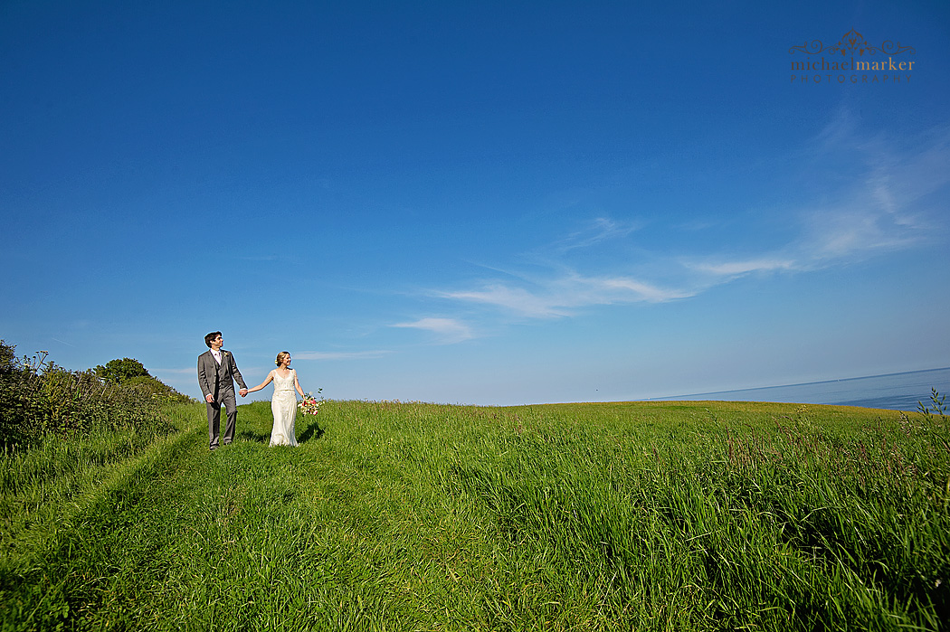 Rosevine-wedding couple on hill overlooking beach