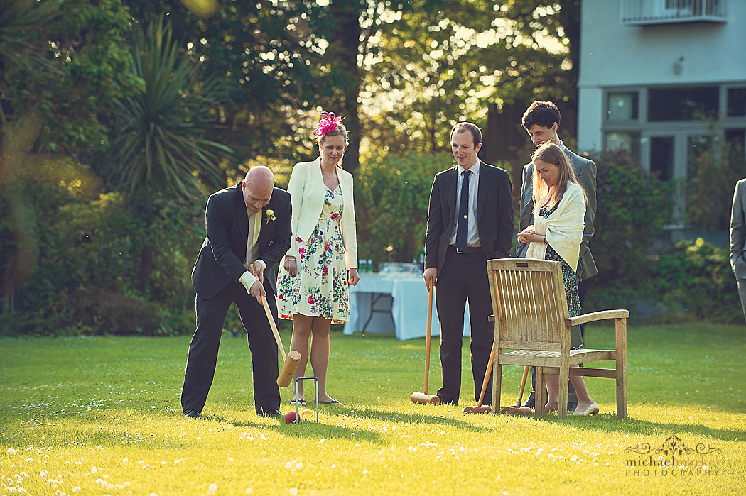 Wedding guests playing croquet on the lan at Th Rosevine in Cornwall