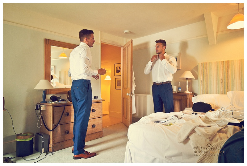 Groom and best man dressing for Cornish wedding