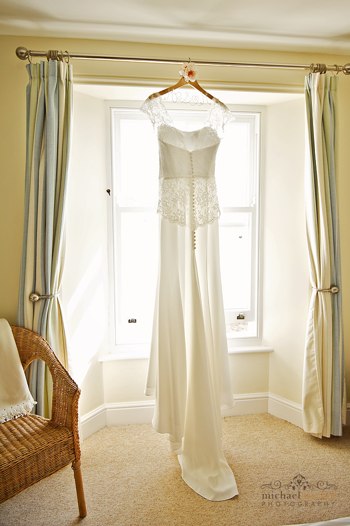 Cornish wedding dress hanging in the window at Cawsands