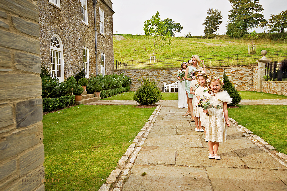 Flowergirls and bridesmaids waiting at Shilstone House wedding