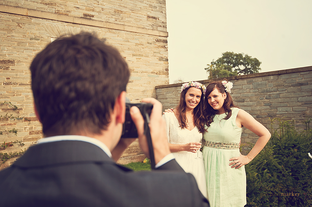 Bride-and-bridesmaid-being-photographed