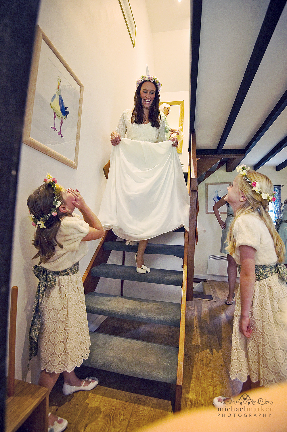Bride-coming-down-the-stairs-Hope-Cove