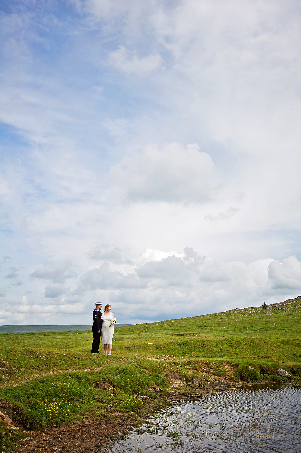 Bride and groom in front of Tor on dartmoor in devon