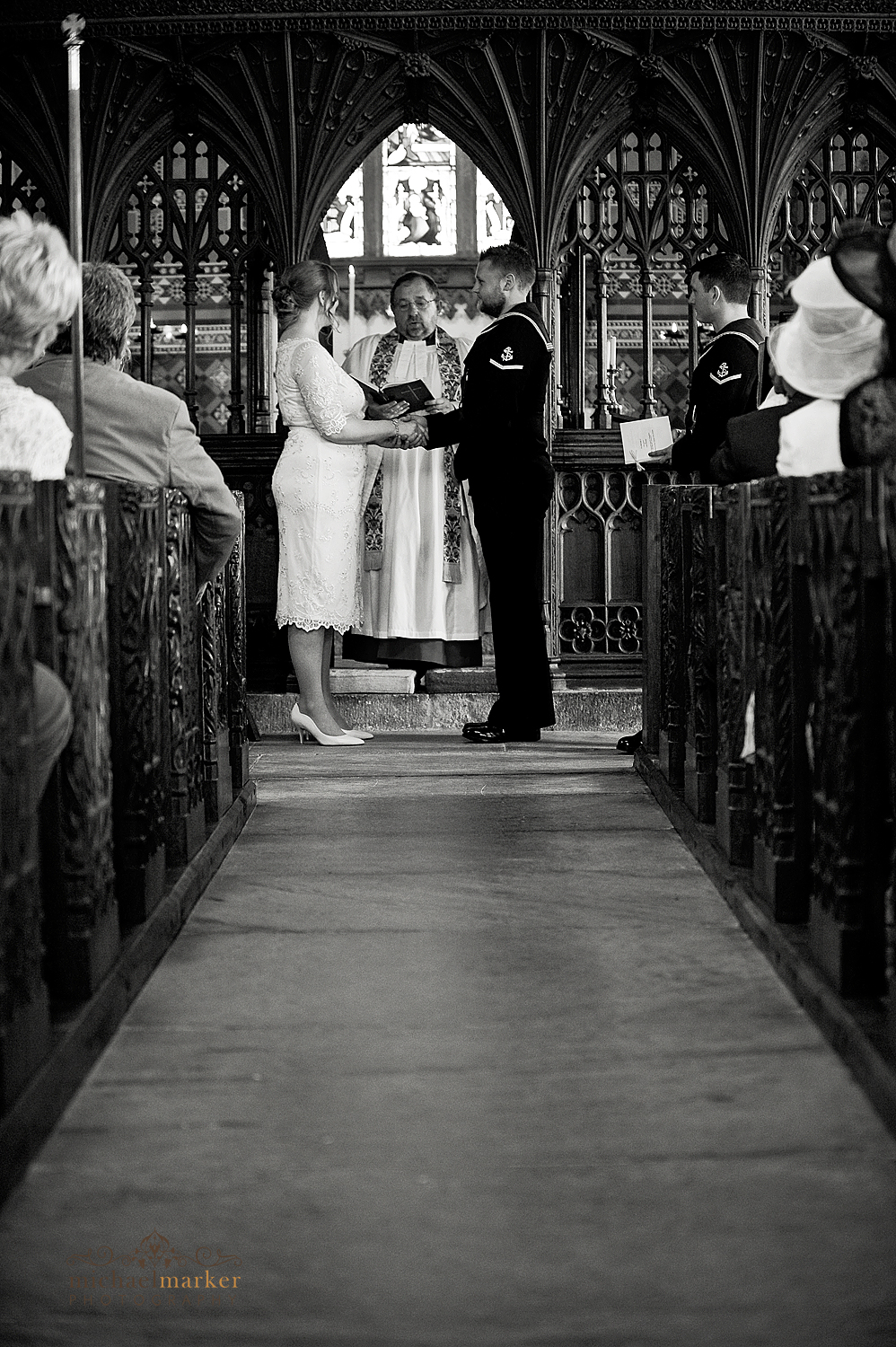 Bride and groom exchanging vows in Sheepstor Church devon