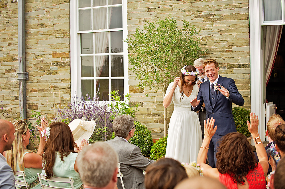 Devon-garden-wedding-ceremony-laughter