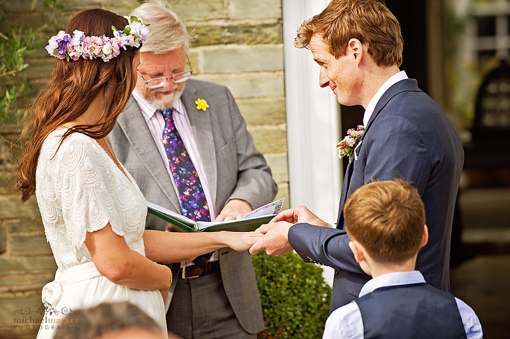 Exchanging-rings-in-garden-at-Devon-wedding