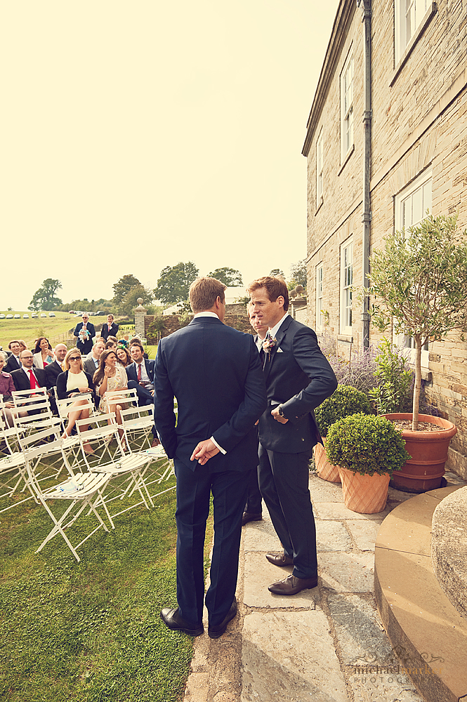 Groom-waiting-for-the-bride-at-Shilstone-House-devon