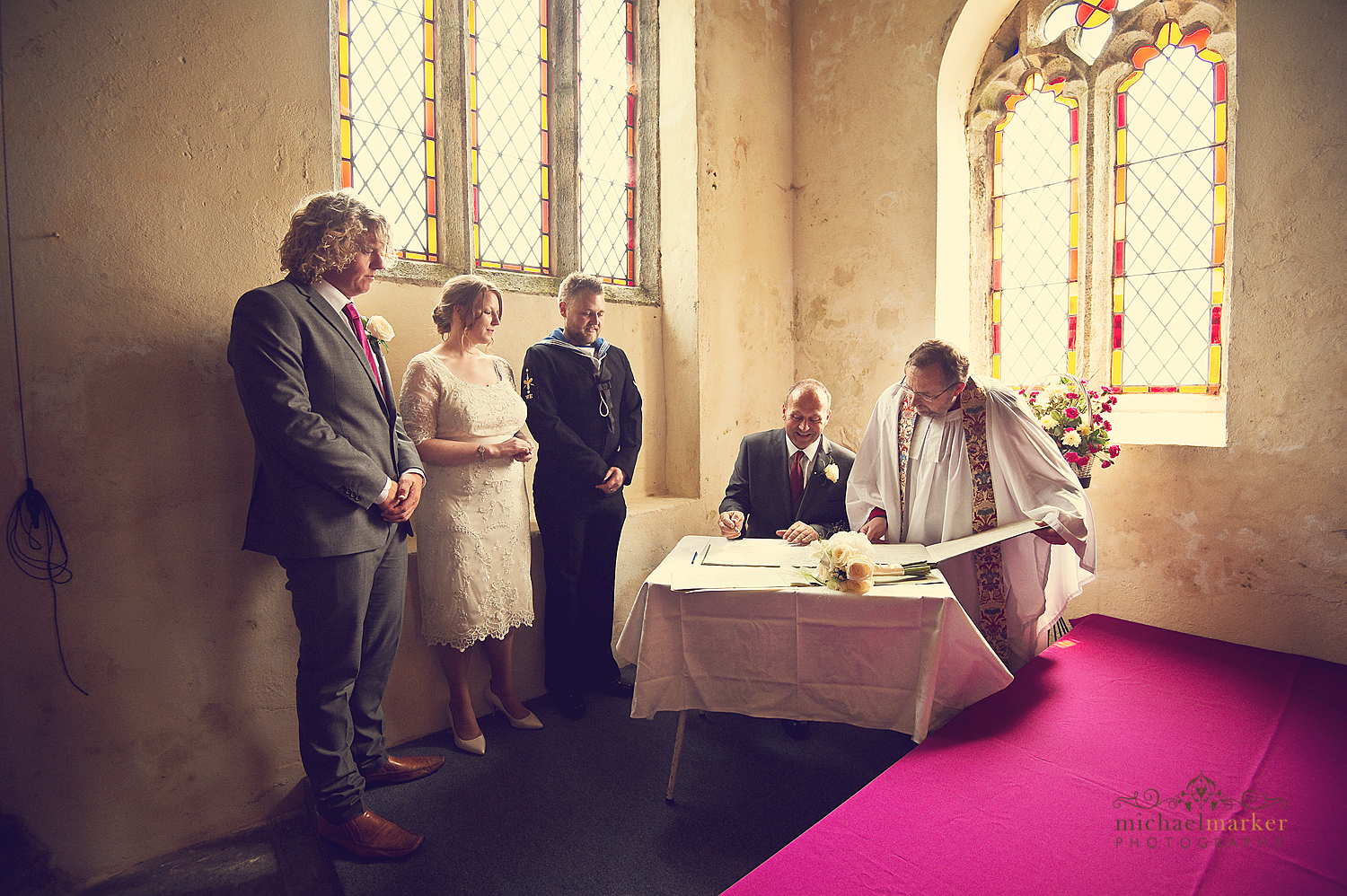 Signing the marriage register at Sheepstor Church on dartmoor