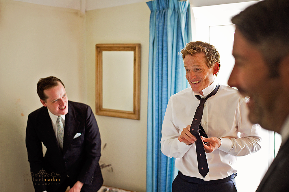 Groom getting ready for wedding at Hope Cove in Devon