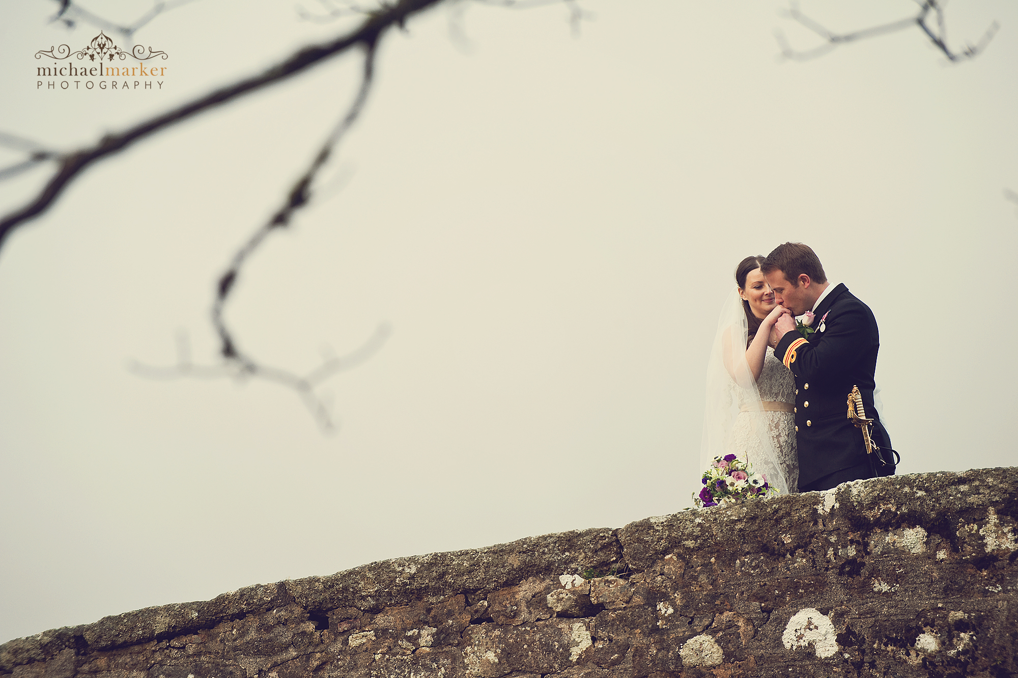Couple kissing on their wedding day at two Bridges Hotel in Devon