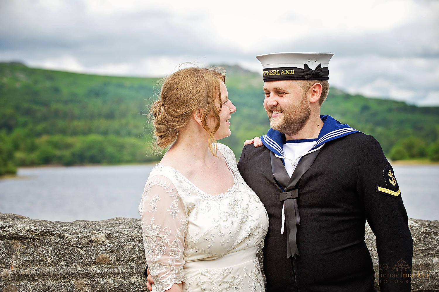 Bride and groom looking into each others eyes at Burrator reservoir