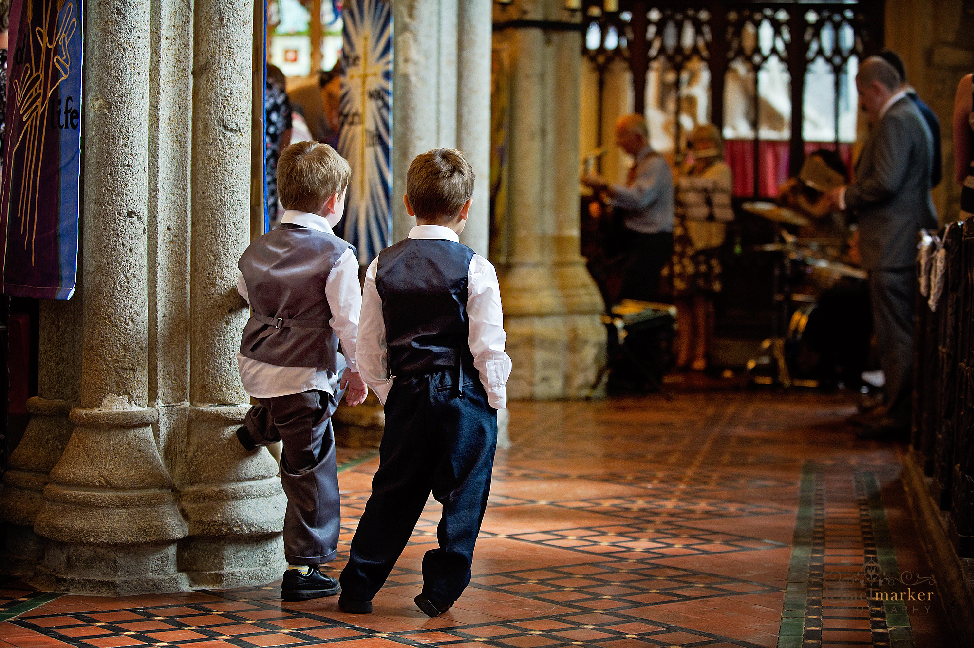 Milton Combe church wedding ushers looking on