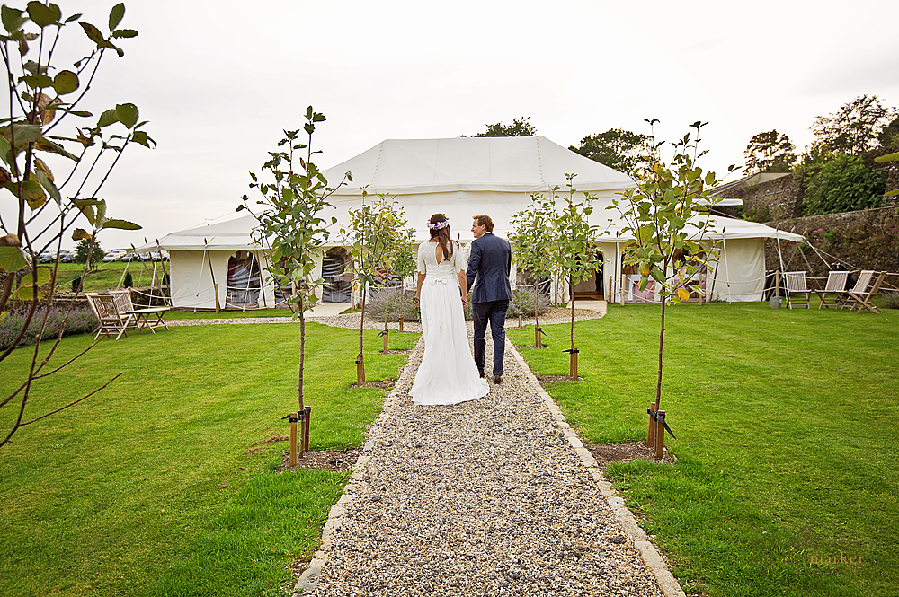 walking-to-wedding-marquee-at-Shilstone