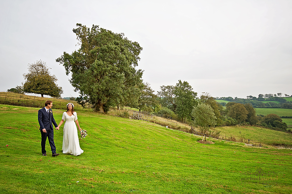wedding-couple-walking-in-grounds-at-Shilstone