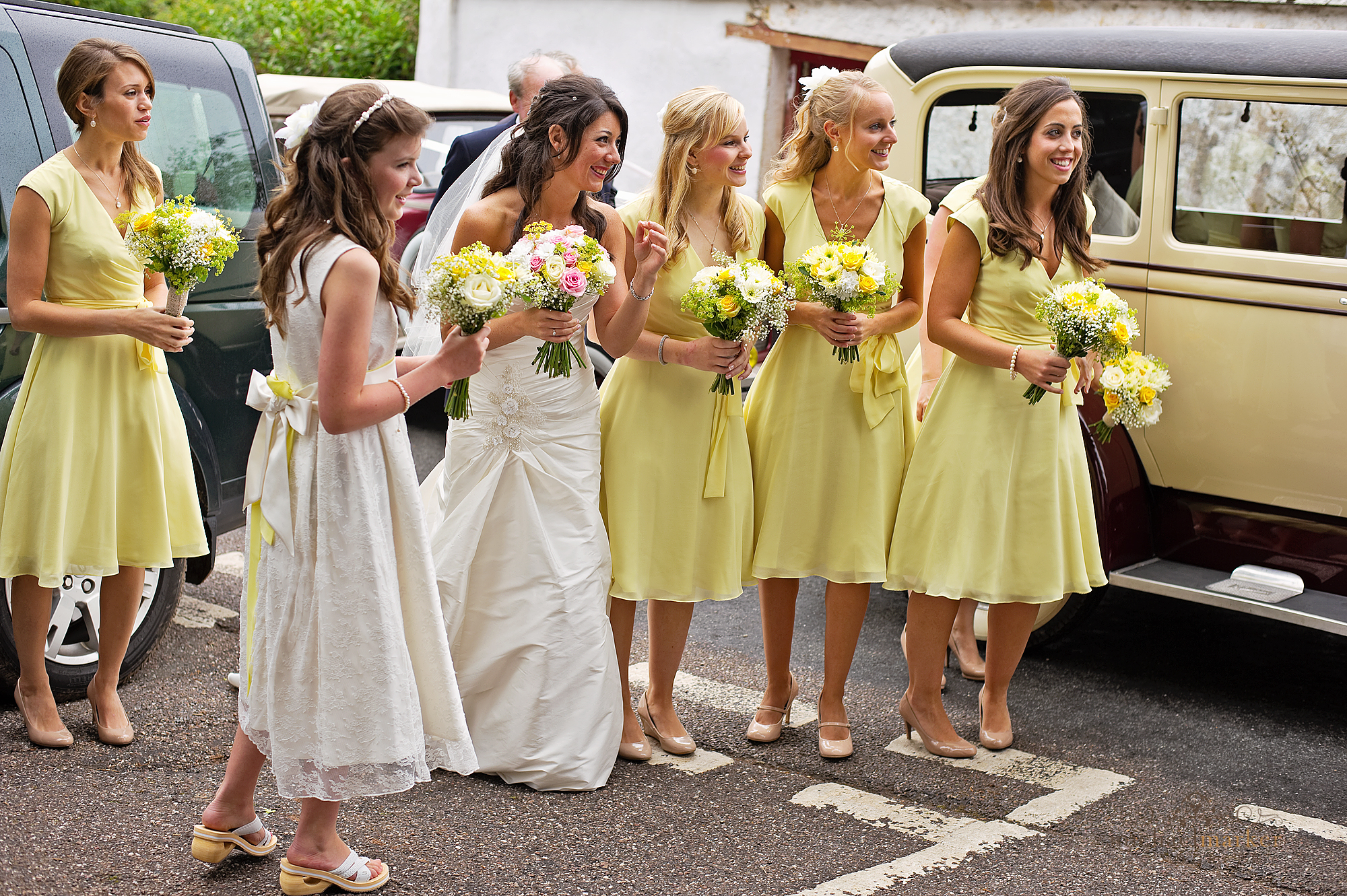 Bride and bridesmaids outside Bickleigh Church