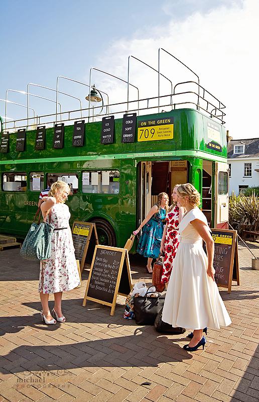 Bride and bridesmaids vintage bus in Kingsbridge in Devon