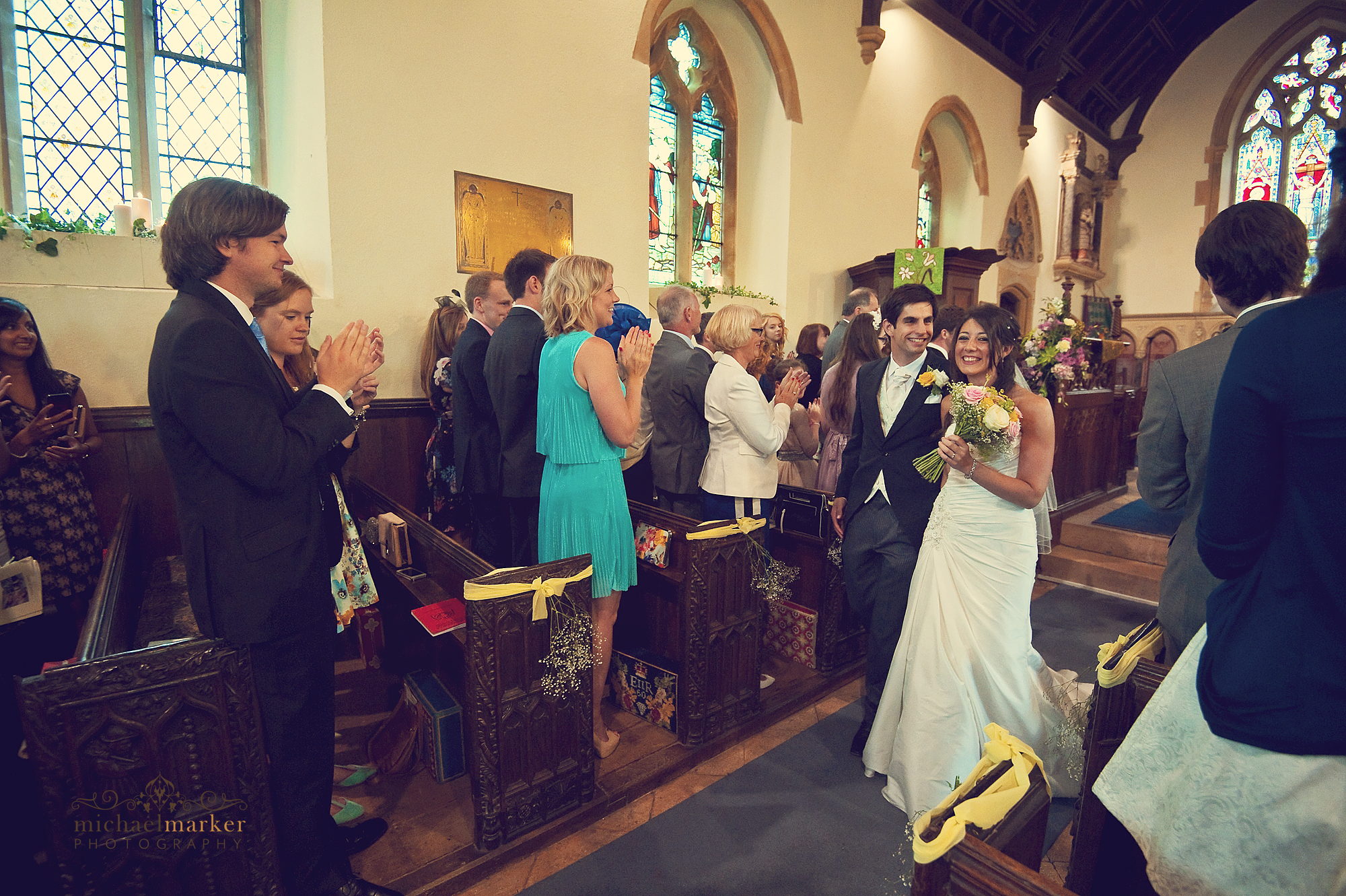 Bride-and-groom-exiting-wedding-service