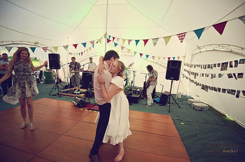 Bride and groom huging at Devon marquee wedding