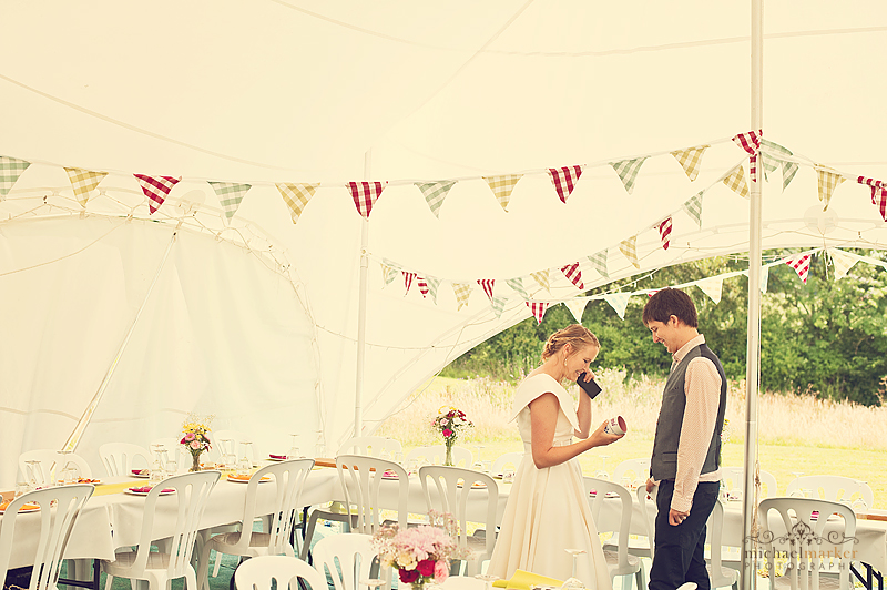 Bride and groom in wedding Marquee