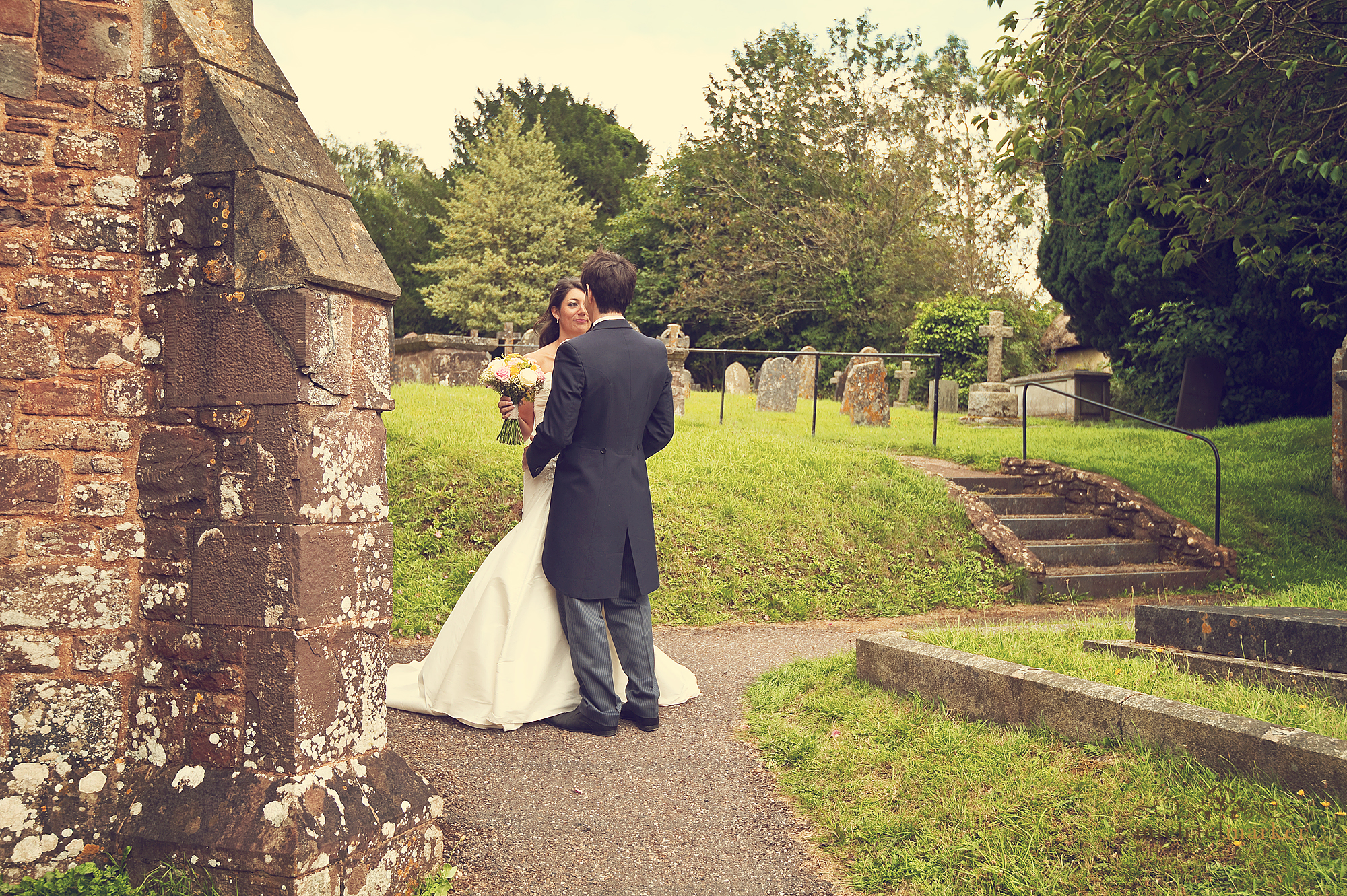Bride and groom outside doorway of Bickleigh Church