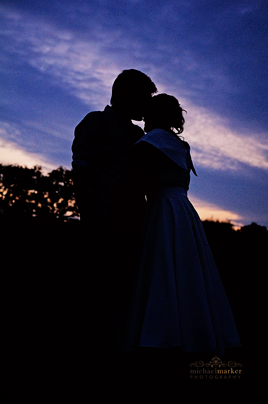 South Devon wedding sunset silhouette of bride and groom