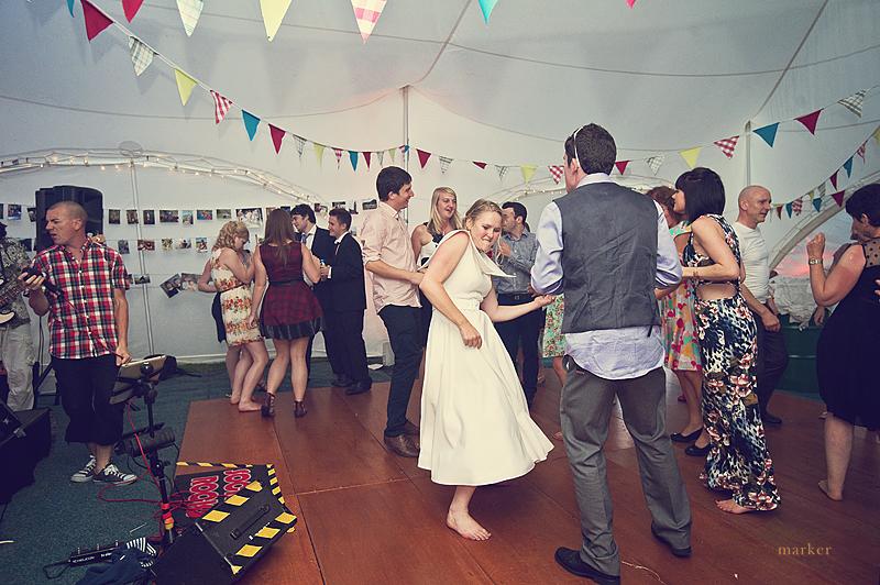 Bride dancing with guests at devon wedding