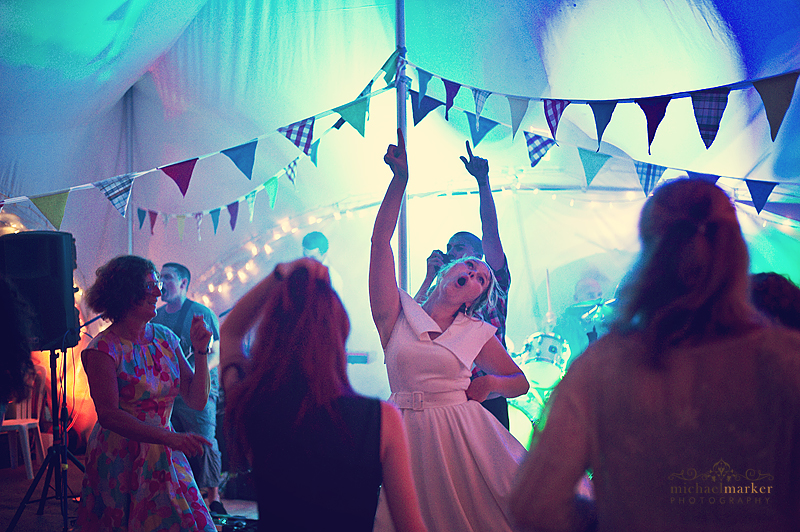 bride dancing on wedding day as punk band plays in the background