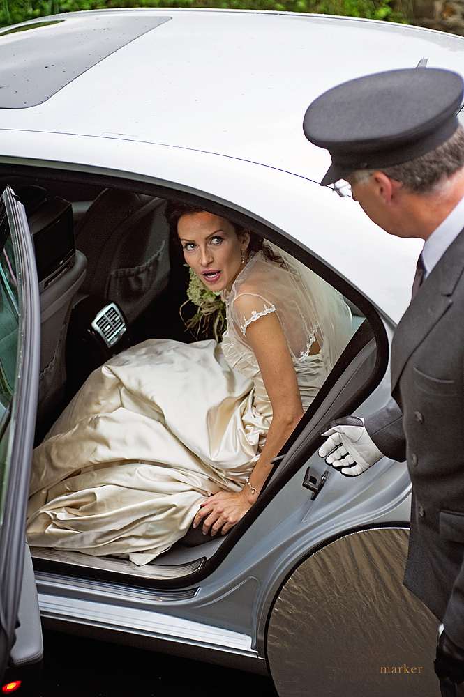 bride in silver wedding car