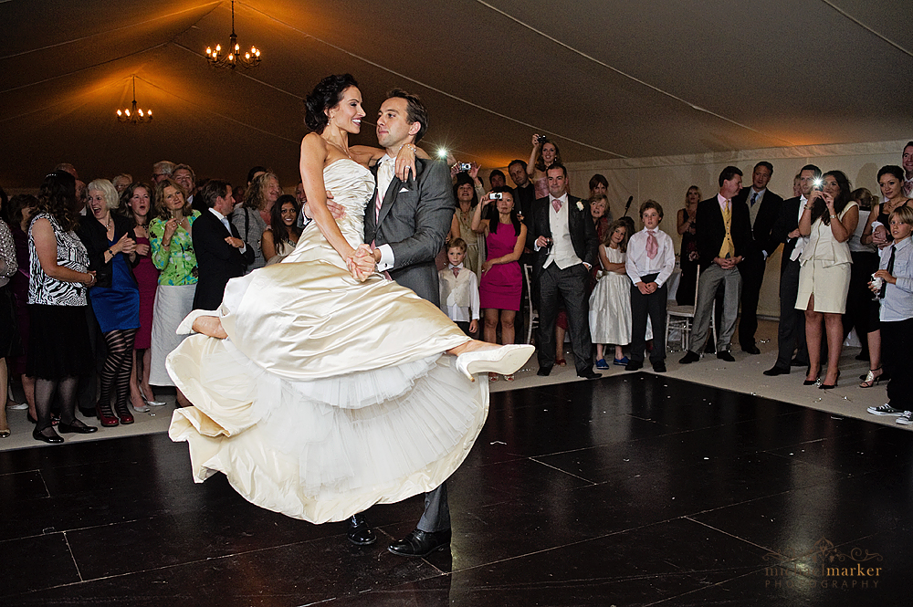 Bride and grooms first dance at Devon wedding  as guests watch