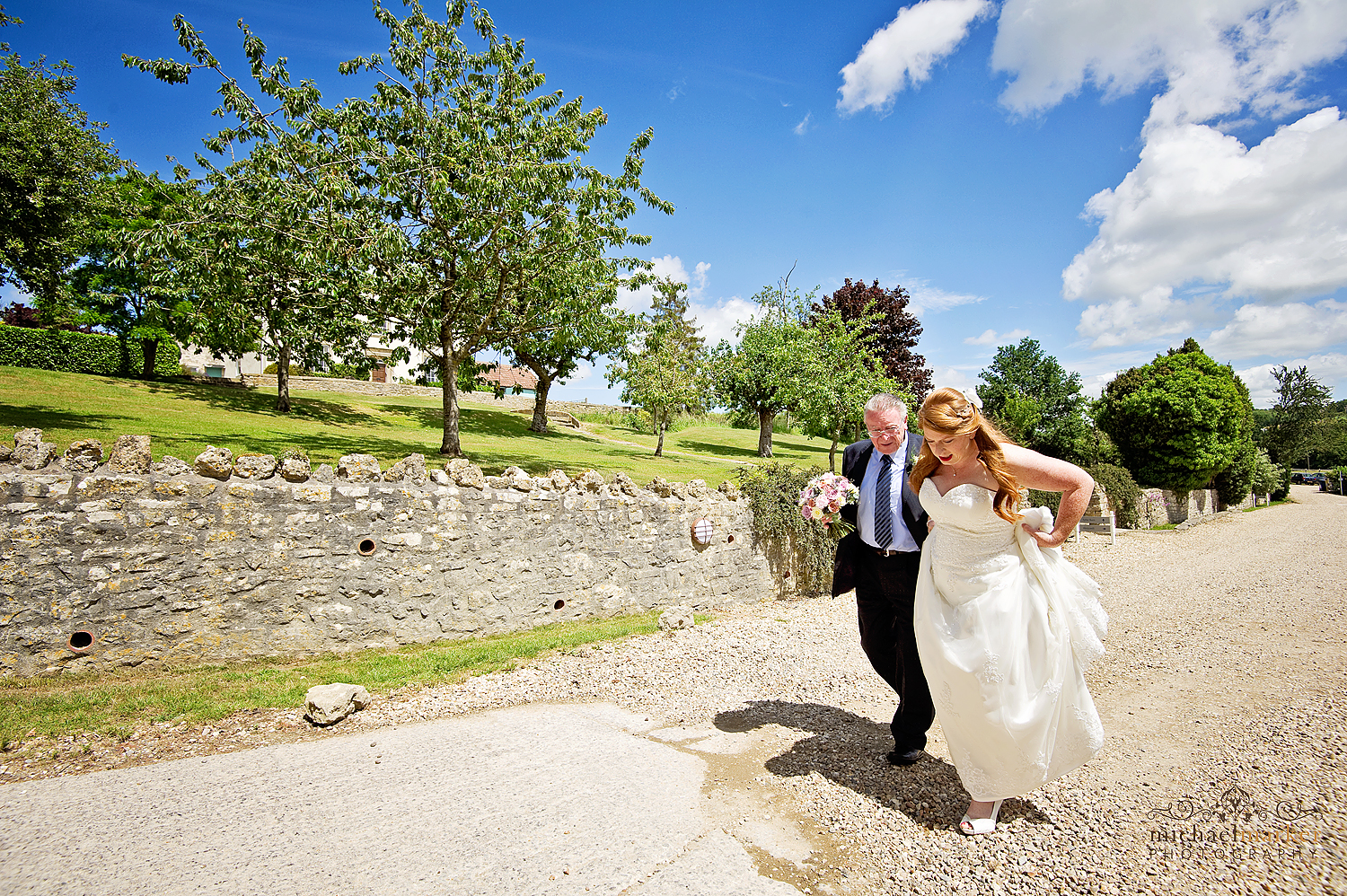 Bride arriving with her father at Priston Mill near Bath