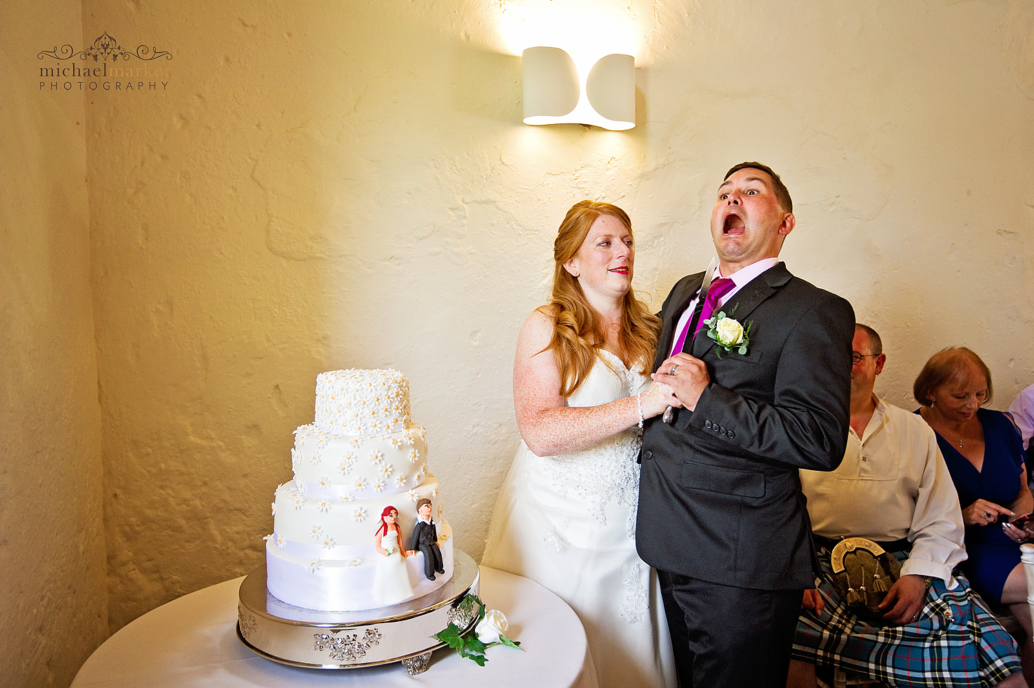 Funny wedding cake cutting at Priston Mill near Bath