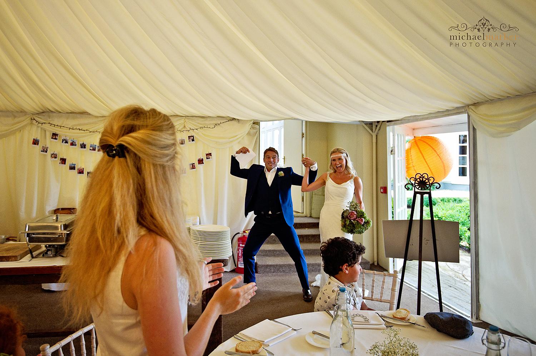 Groom celebrating at Deer Park wedding reception