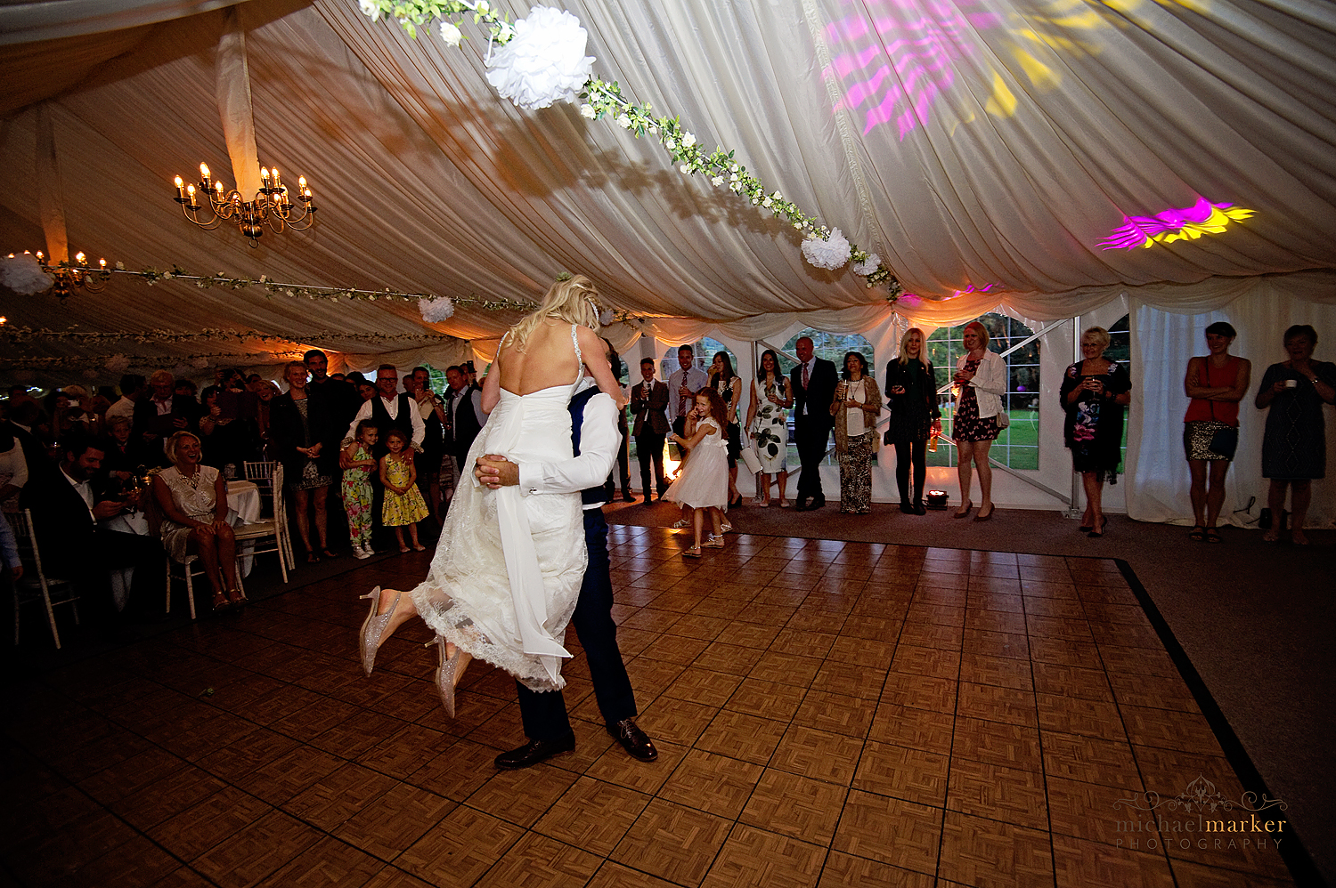 Groom lifting the bride during their first dance at Deer Park wedding in Devon