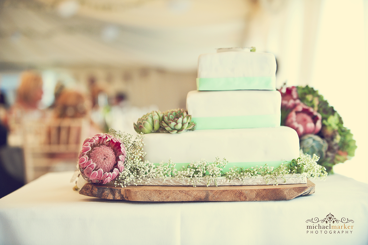 wedding cake decorated with Protea flowers at Deer Park wedding