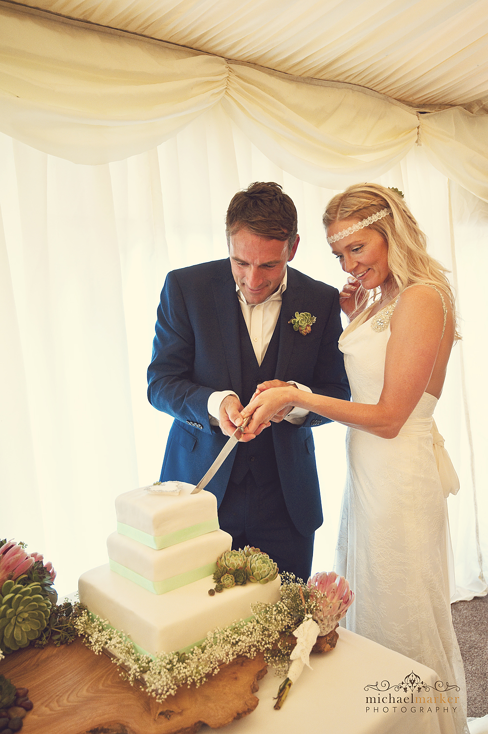 Bride and groom cutting cake at Deer Park wedding reception near Exeter