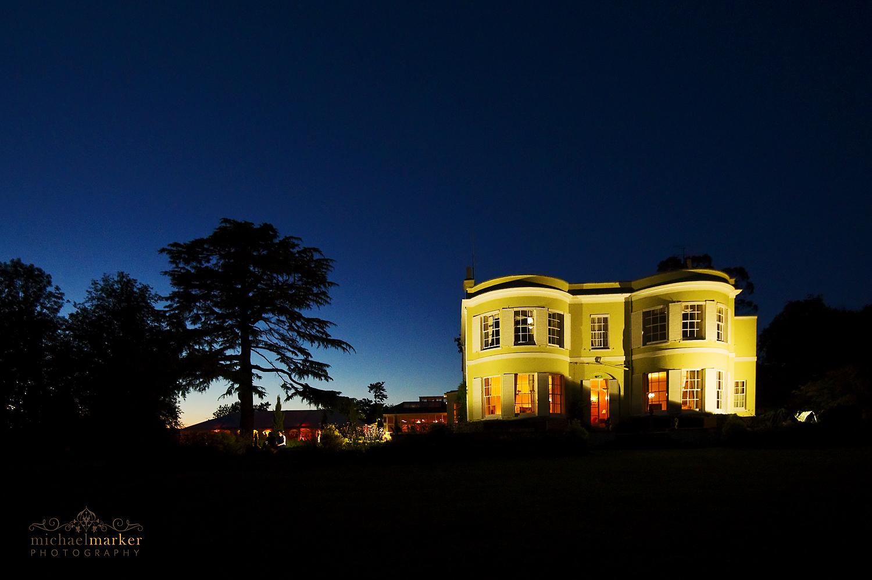 Deer Park hotel lit up at night for summer wedding