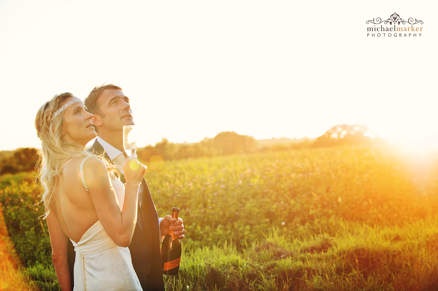 Bride and groom near Exeter at sunset with champagne