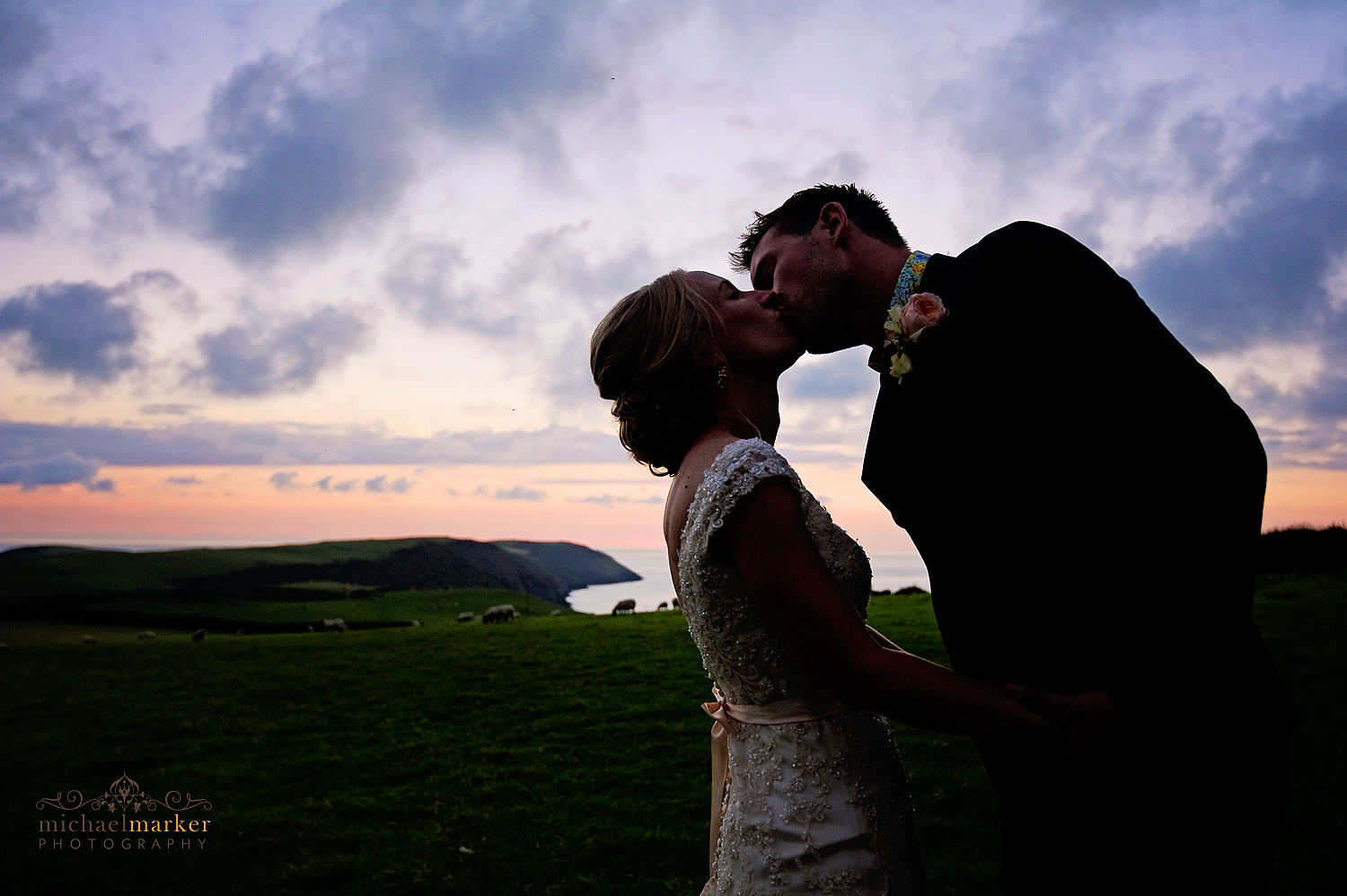 beautiful sunset kiss at North Devon wedding