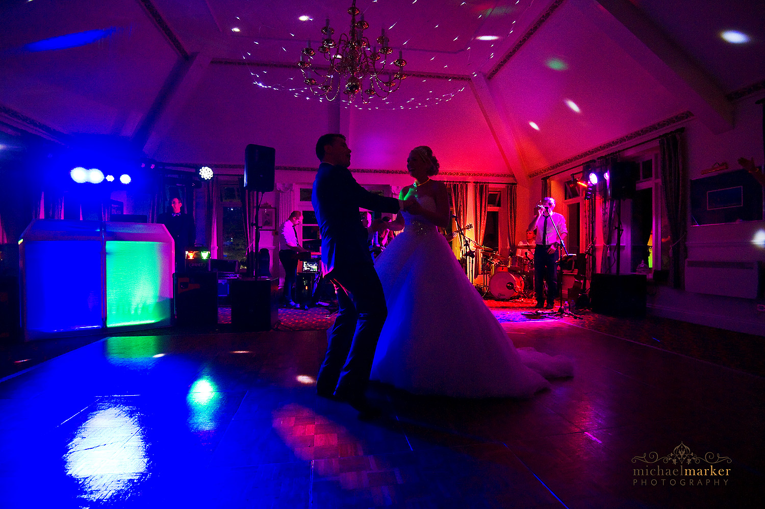 Bride and groom silhouette dancing at evening reception