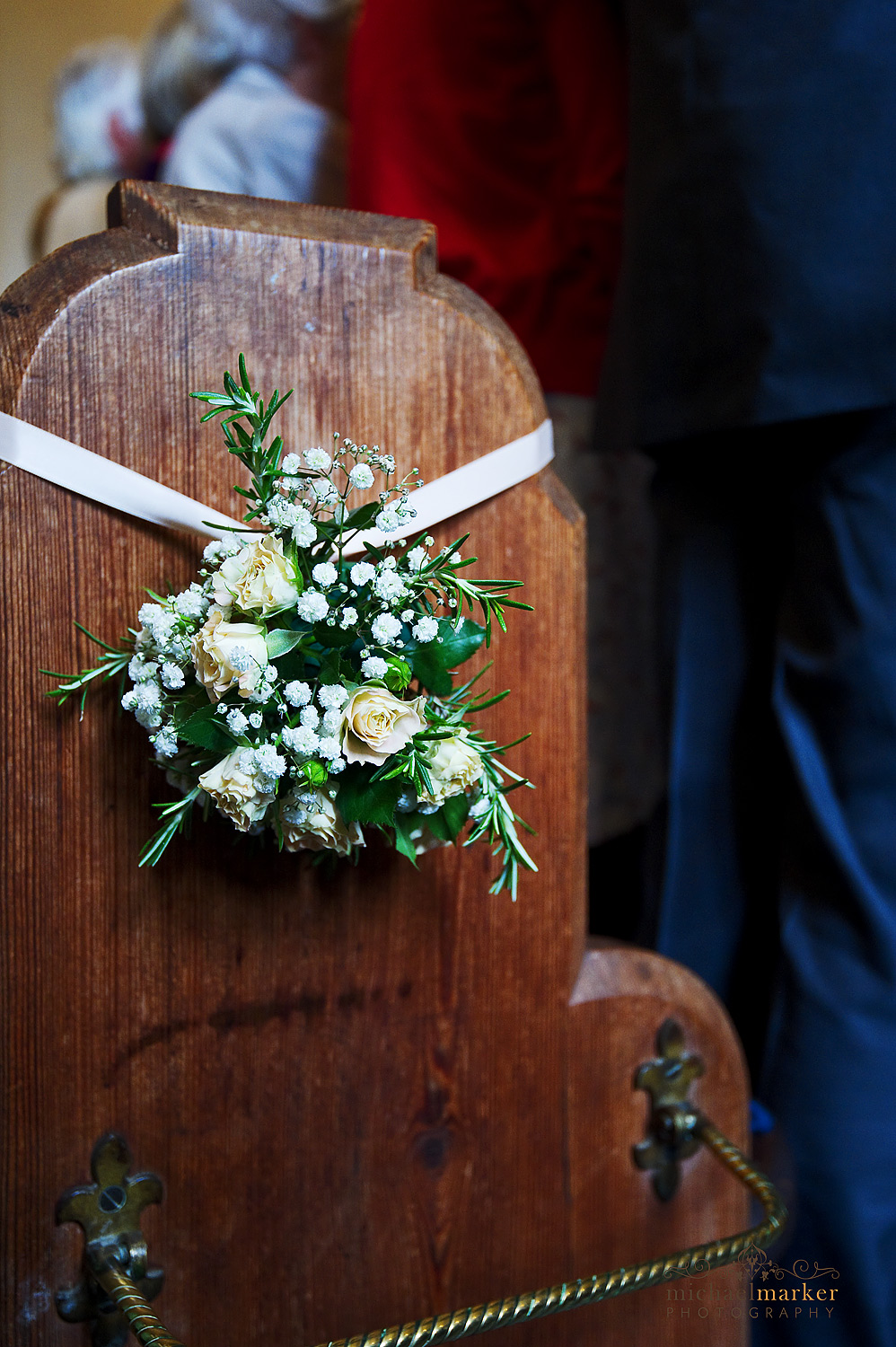Wedding pew end flowers in Whitchurch Church