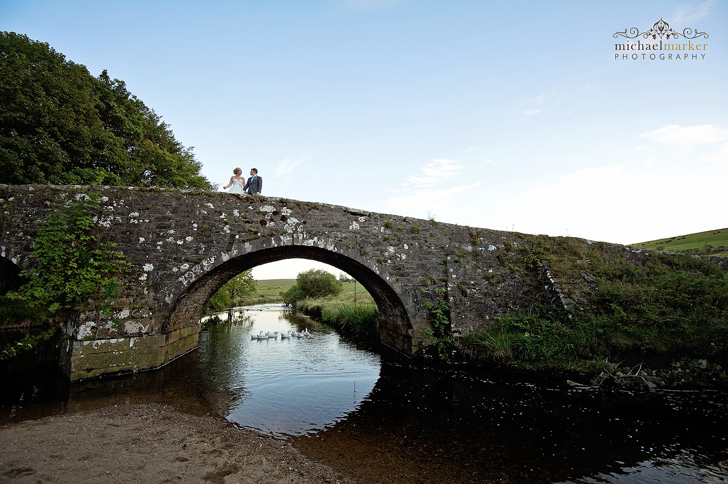 Bride and groom on the bridge at Two Bridges Hotel