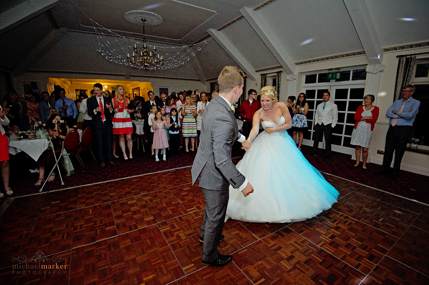 Bride and groom dancing their first dance at Two Bridges