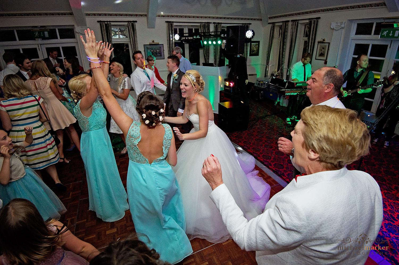 Bride dancing with her three bridesmaids at Two Bridges wedding in Devon