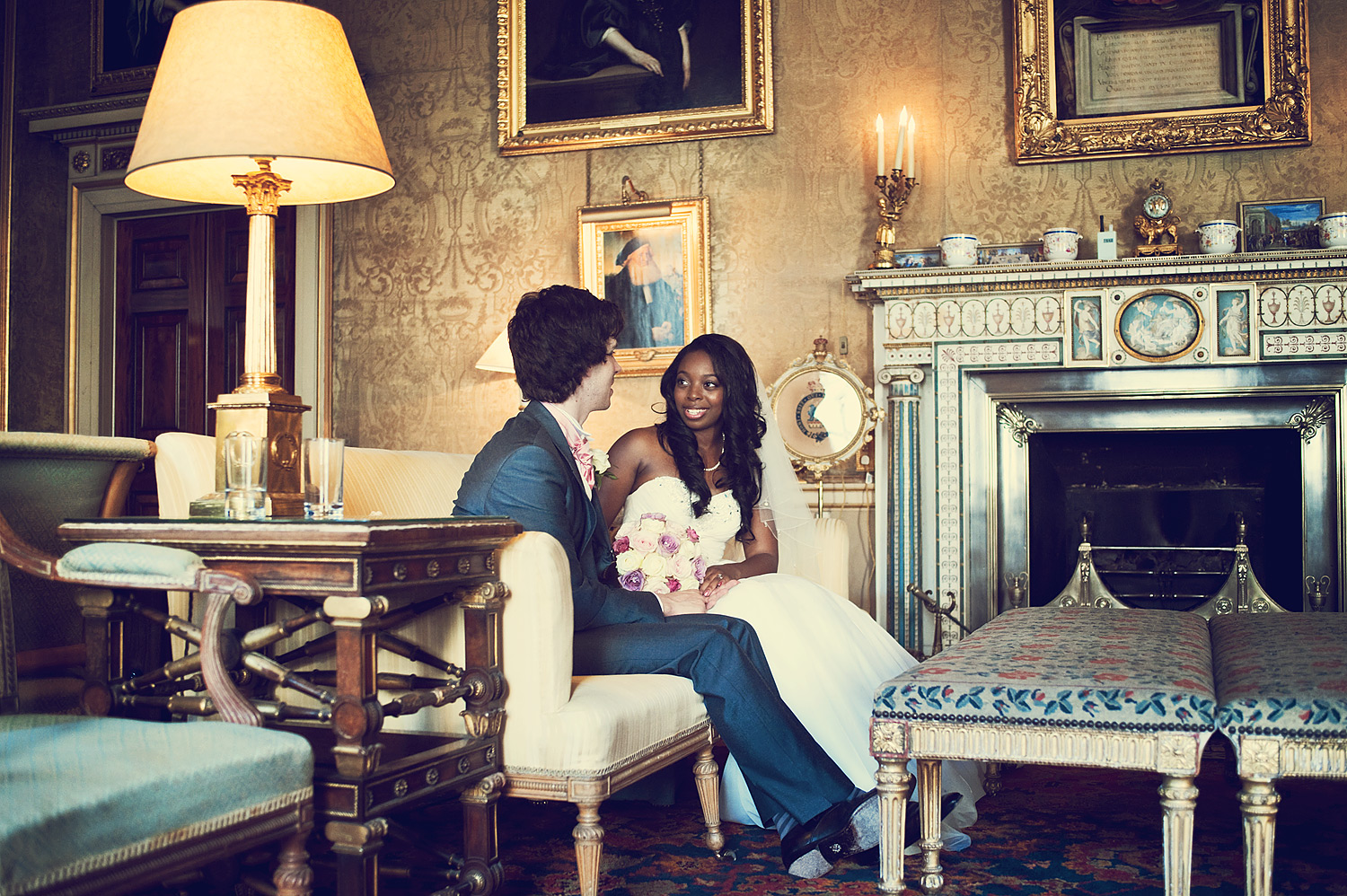 Wedding couple seated in drawing room at Syon House in London.