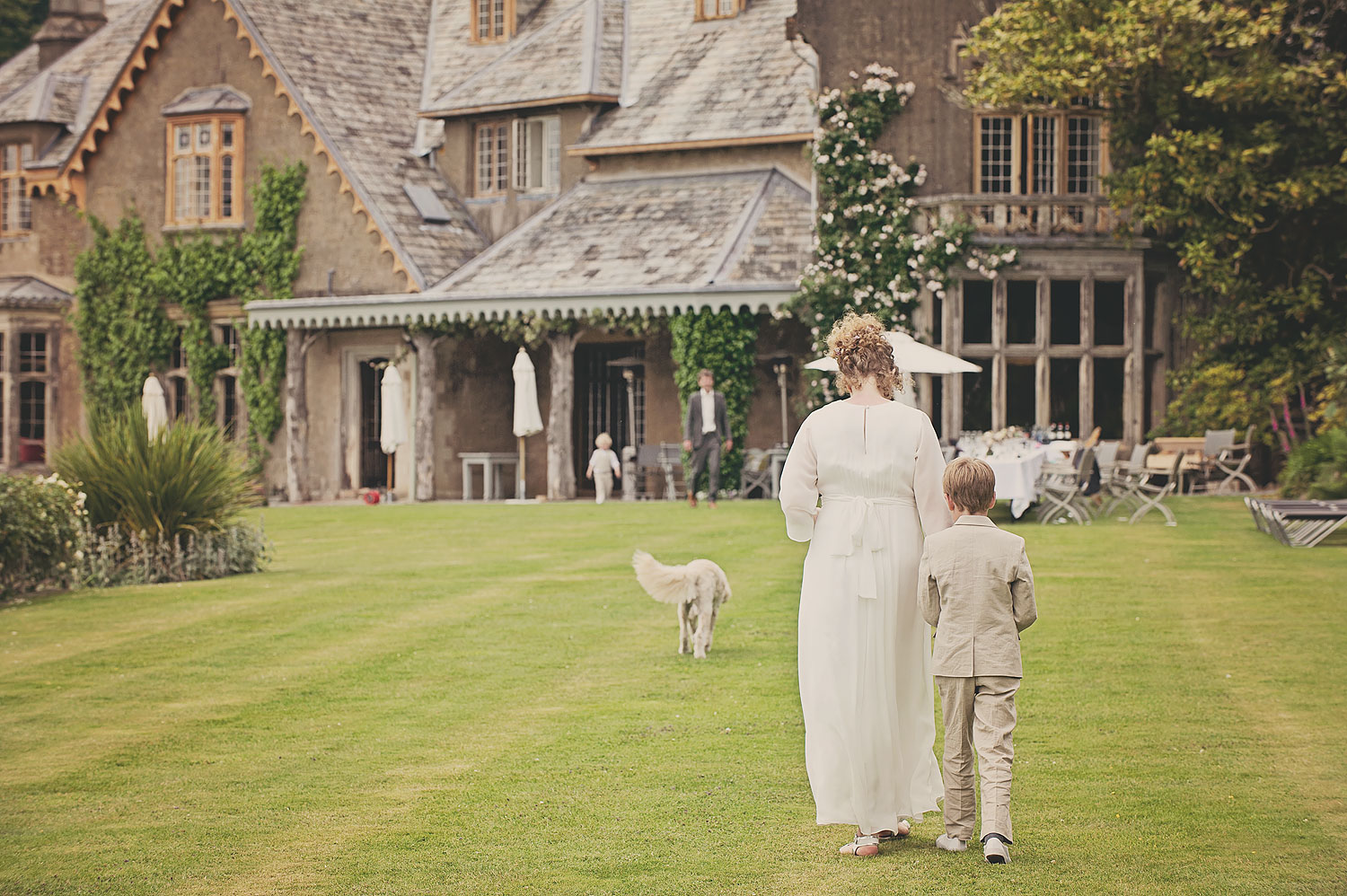 Bride and page boy on terrace at Hotel Endsleigh in Devon.
