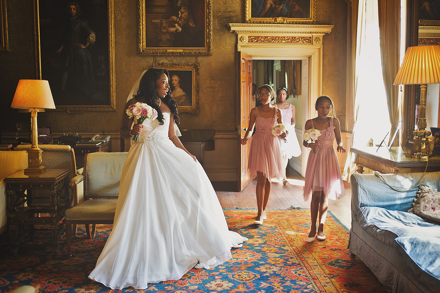 Bride and bridesmaids in drawing room at Syon Park in London.